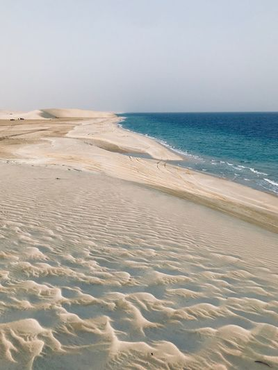 Arabian Moment Land Beach Sea Water Sand Beauty In Nature Sky No People Horizon Clear Sky Idyllic Horizon Over Water Sunlight Nature Tranquility Outdoors Scenics - Nature Tranquil Scene Day