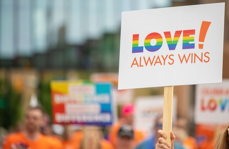 Love always wins sign at a Pride Parade Wins Love Sign Ohio Columbus, Ohio Prideparade Pride Parade Pride Text Focus On Foreground Western Script Communication Close-up Sign People Human Body Part Hand Outdoors Multi Colored Human Hand Holding Day Message Capital Letter