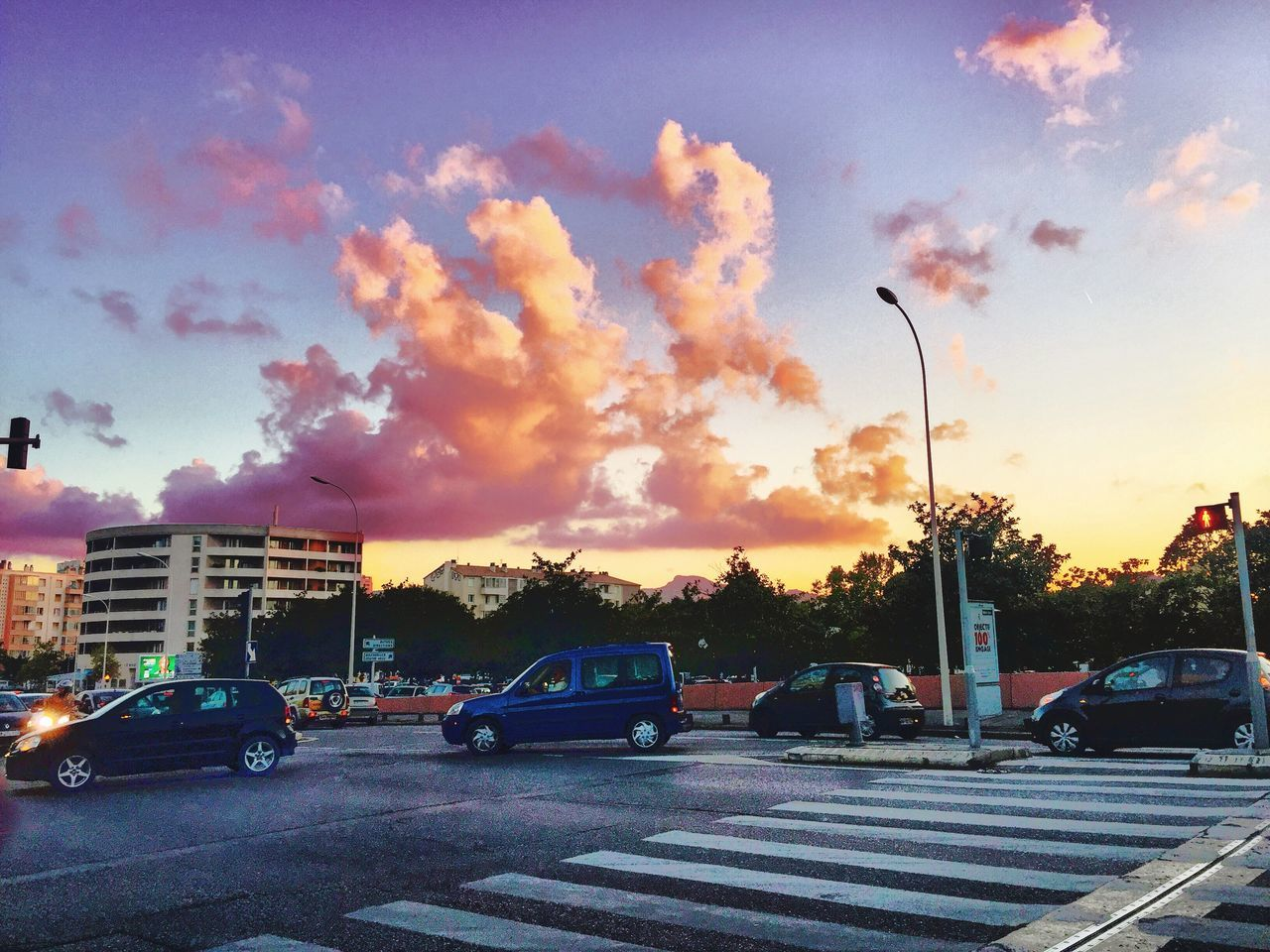 Cars On Road Against Sky During Sunset