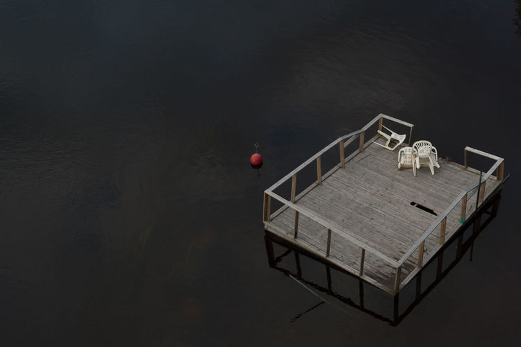 High angle view of wooden platform on lake