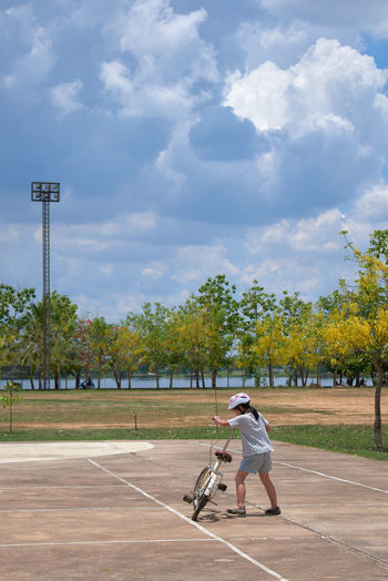 Man playing soccer on field against sky