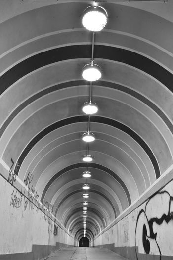 Low angle view of illuminated lights in tunnel