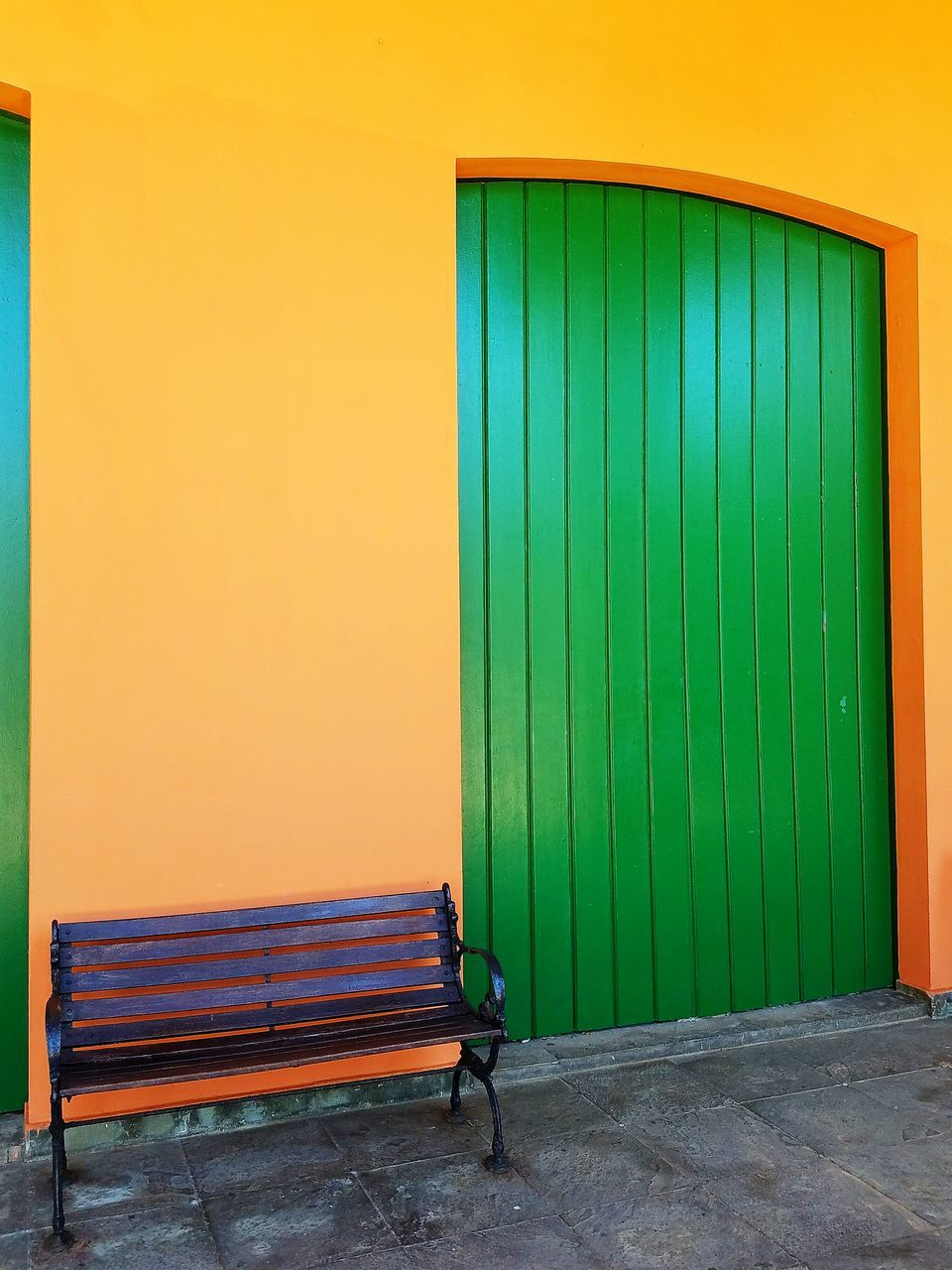 architecture, entrance, built structure, closed, wall - building feature, door, building exterior, day, security, empty, safety, protection, building, no people, wall, orange color, shutter, green color, outdoors, iron