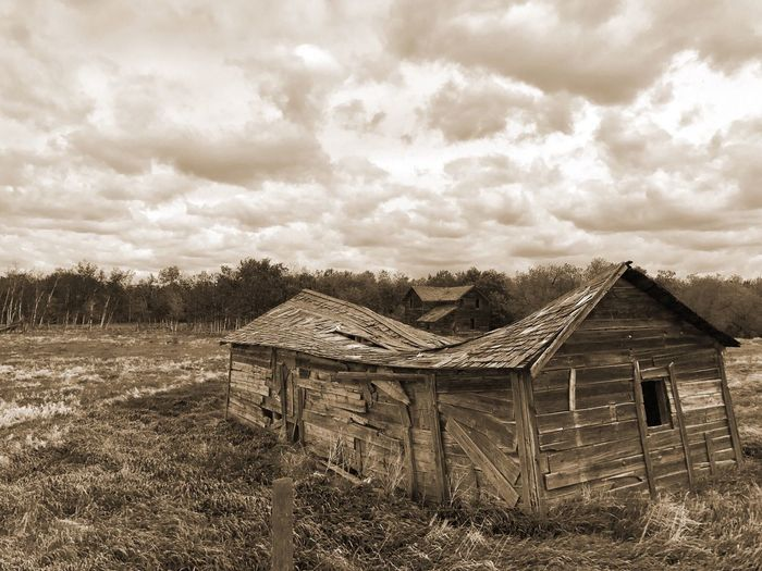 Abandoned built structure on field against sky