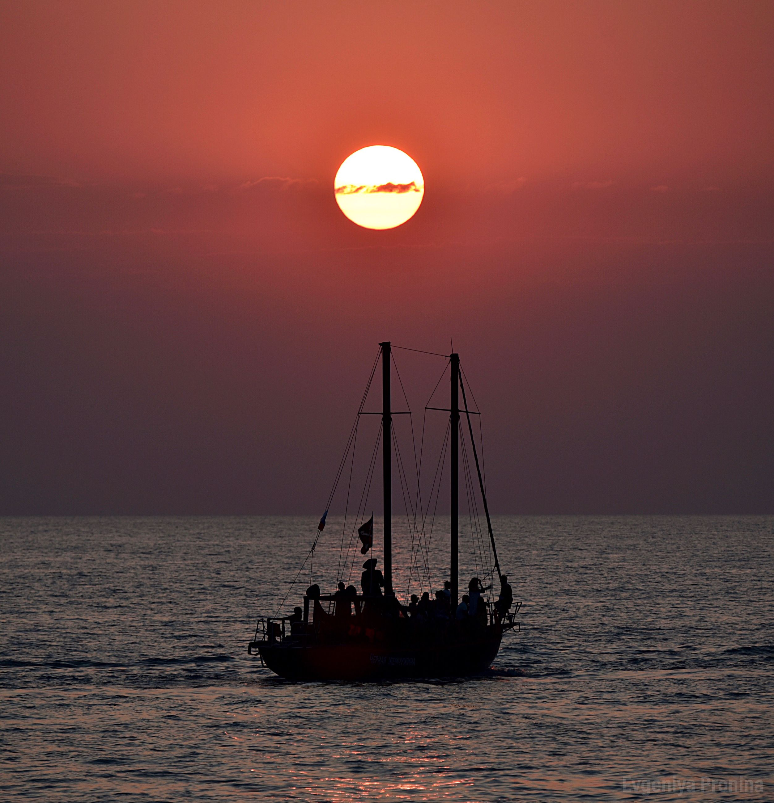 sea, sky, water, sunset, nautical vessel, scenics - nature, horizon over water, sun, waterfront, beauty in nature, transportation, horizon, silhouette, orange color, mode of transportation, idyllic, tranquility, nature, tranquil scene, sailboat, outdoors