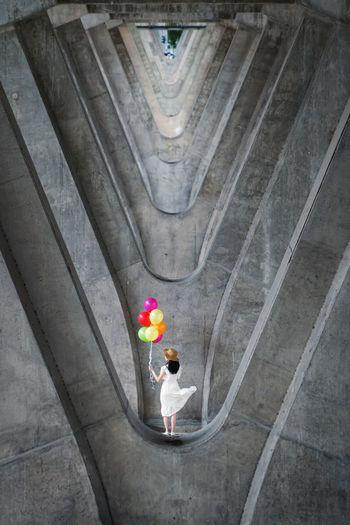 High angle view of man holding umbrella