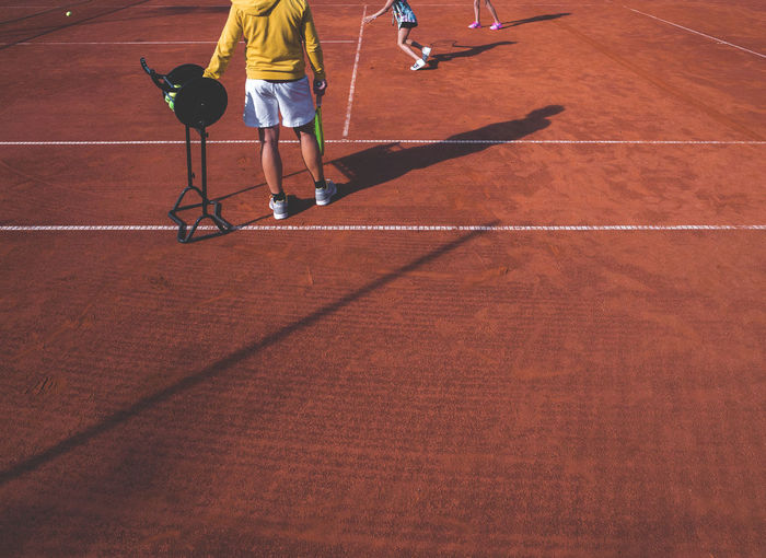 People At Tennis Clay Court