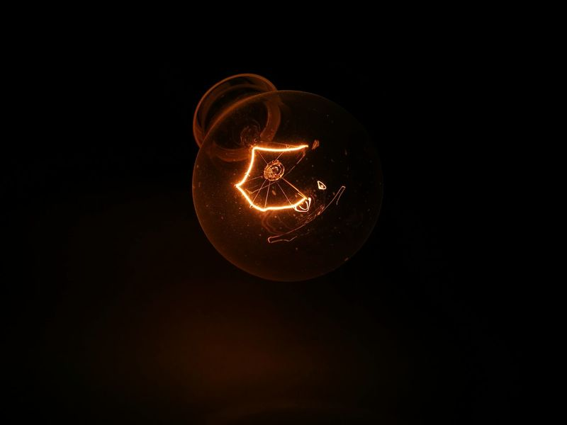 Light Light And Shadow Lightbulb Lightbulbs Filament Filament Light Filament Bulb Electric Electricity  Electrical Equipment Design Logo Voltage Power Glow Emission Darkness Dark Orange Red Wire Coil Architecture Architectural Detail Construction