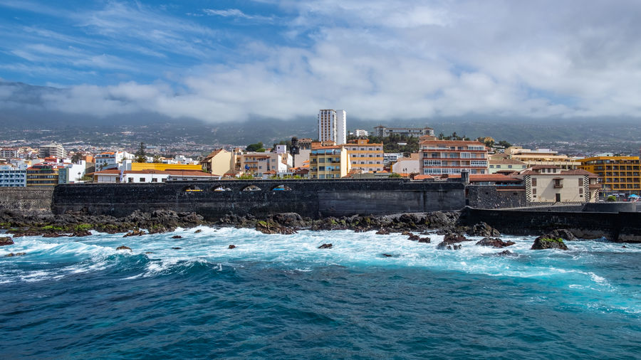 Puerto de la Cruz the beautiful city in the north of Tenerife. Here views from the water side. The coast to San Telmo and of course the harbor with the harbor entrance. Atlantic Ocean Canary Islands City Cityscape Coastline EyeEm Best Shots EyeEm Nature Lover EyeEm Selects EyeEm Gallery Feliz-Photo Harbor Nature Nature Photography Pier Puerto De La Cruz SPAIN Sky And Clouds Wave Coast Eye4photography  Landscape Landscape_photography Port Tenerife Teneriffa