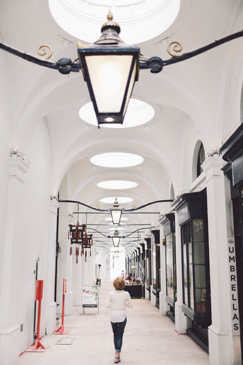 Architecture Blonde Built Structure Ceiling Corridor Curly Hair Electric Light Empty Girl Hanging Light Indoors  Lamp Lamp Post Lantern Lighting Equipment Long The Royal Opera Arcade The Way Forward People And Places London Lifestyle