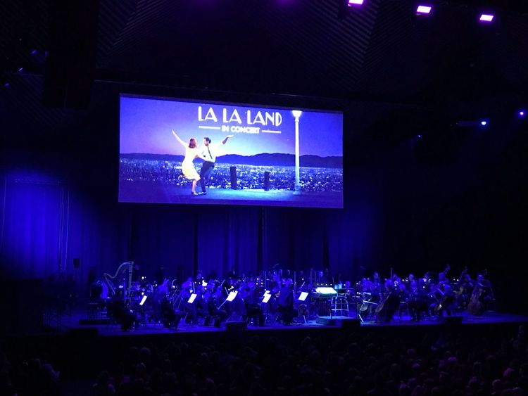 La La Land in Concert in Tempodrom, Berlin at the 8th of January 2018. Orchestra played live while the movie was running. Wonderful experience! #LaLaLand Tempodrom Berlin Tempodrom Cinema Orchestra Orchestra Concert  Concert Concert Hall  Lalaland Night Communication Event Stage - Performance Space Audience Indoors  Crowd People Nightlife Performance
