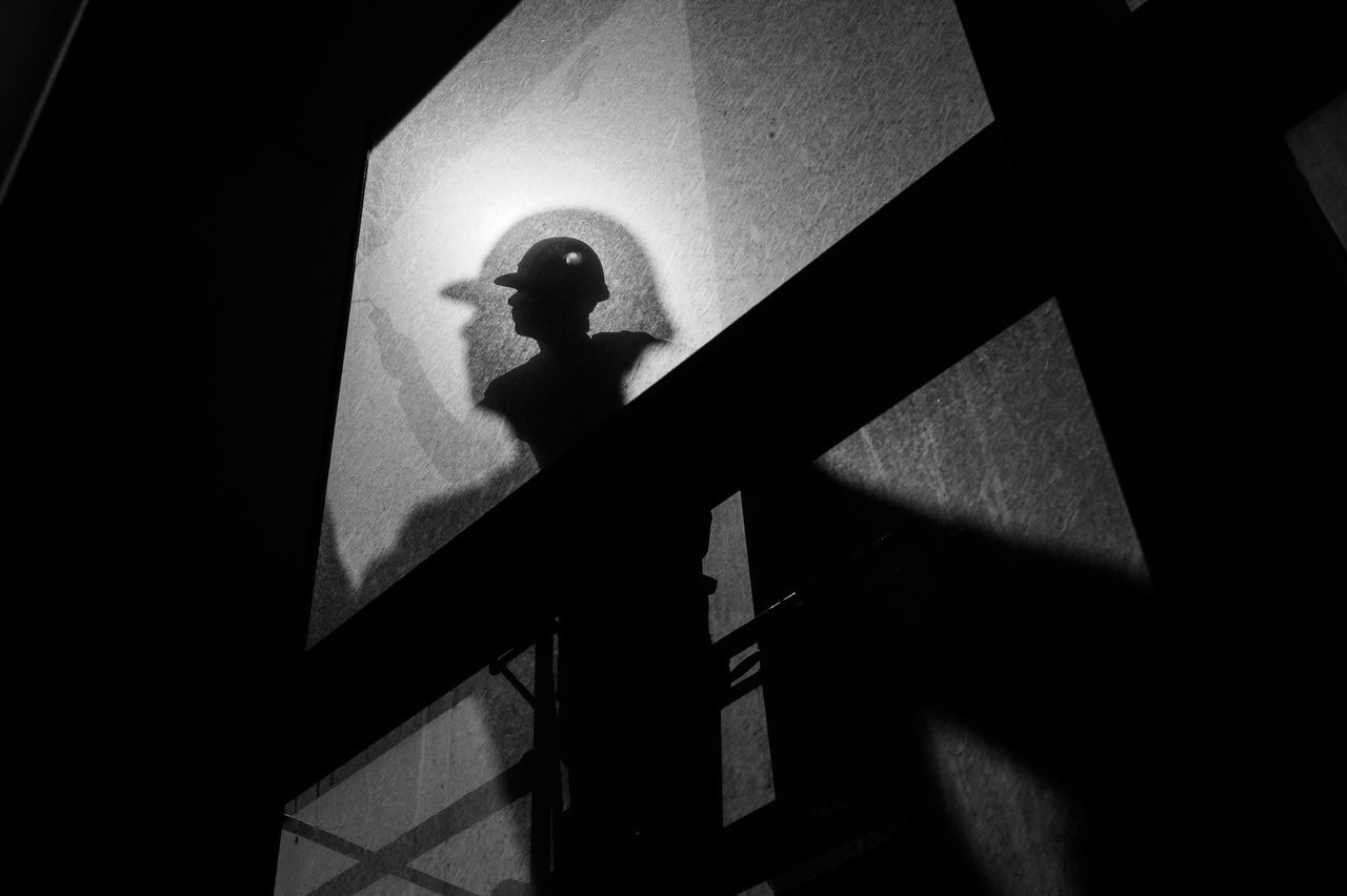 shadow, silhouette, low angle view, architecture, built structure, real people, one person, indoors, night, people