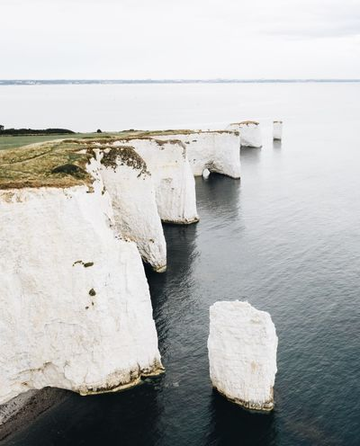 Old harry rocks Water Sea Sky Scenics - Nature Tranquility Rock Tranquil Scene No People Beauty In Nature Horizon Horizon Over Water Nature Beach Solid Rock - Object Non-urban Scene Day Idyllic Land