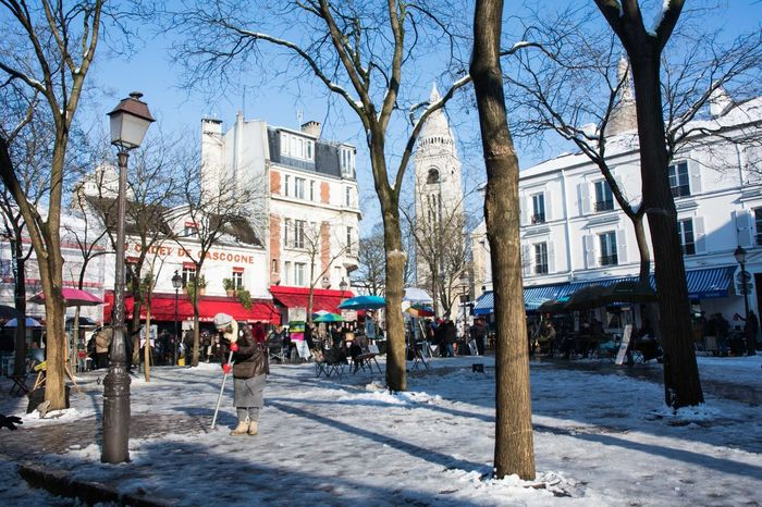 Montmartre, Paris Architecture Bare Tree Branch Building Exterior Built Structure City Clear Sky Day Large Group Of People Nature Outdoors People Place Du Tertre Sky Snow Tree Winter