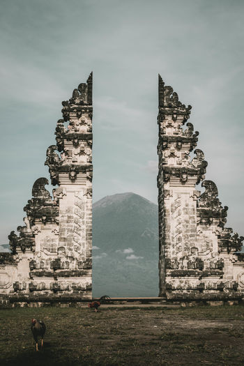 ASIA Bali Gate INDONESIA Mount Agung Pura Lempuyang Ancient Ancient Civilization Architecture Building Exterior Built Structure Day Gunung Agung History Mountain Nature Old Ruin Outdoors Pura Lempuyang Luhur Pyramid Real People Sky The Past Travel Destinations Volcano
