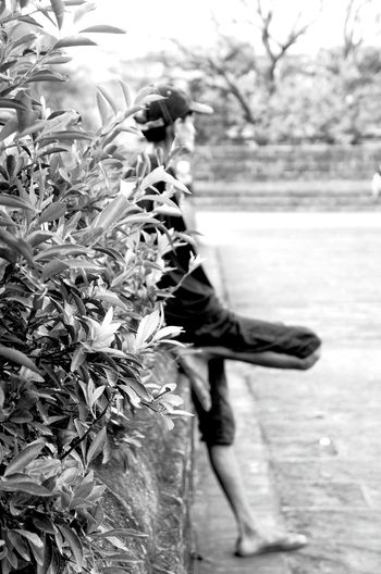 A man watching a futsal/football practice game standing as cool as he is. Blackandwhite Black And White Black & White Blackandwhite Photography Black And White Photography Black And White Collection  Intramuros,manila Historical Place Landscape_photography Historical Monuments People City Life Human