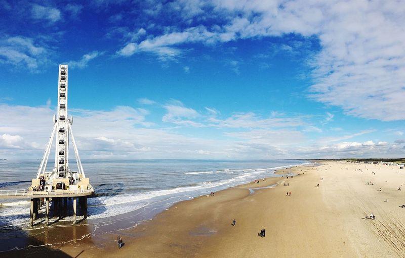 Ferris wheel at beach against sky in scheveningen
