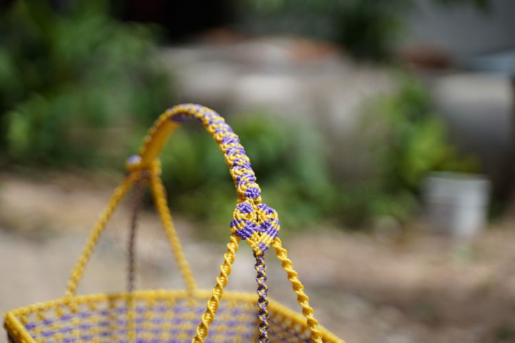 Close-up of multi colored rope in park
