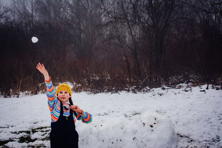 Bare Tree Child Childhood Children Only Cold Temperature Day Fun Happiness Nature One Person Outdoors People Playing Portrait Real People Sky Smiling Snow Standing Tree Warm Clothing Weather Winter