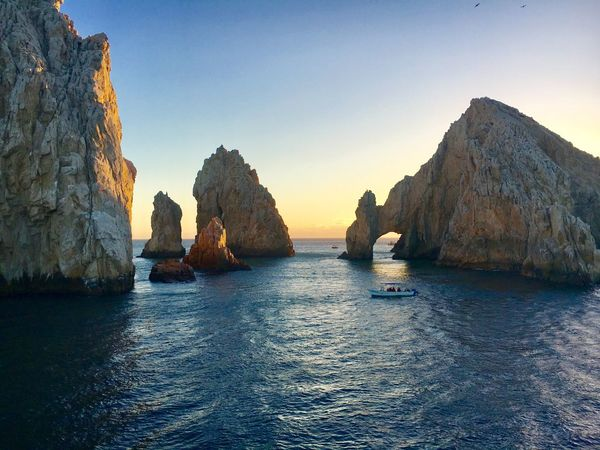 Cabo San Lucas Mexico Lands End Sea Rock - Object Beauty In Nature Nature Rock Formation Water Scenics Tranquility Tranquil Scene Cliff Waterfront Outdoors Day No People Sky Nautical Vessel Natural Arch Travel Photography Travel Destinations The Arch Miles Away