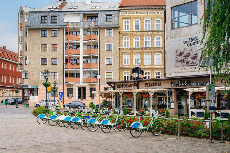 Bicycles parked on street by building