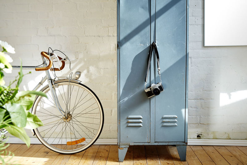 Bicycle By Locker Against Wall At Home