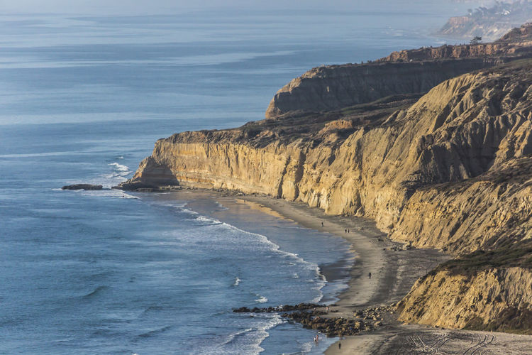 California Nature Sunlight Beach Beauty In Nature Blacks Beach Cliff Day Eroded Idyllic Nature Ocean Outdoors Rock Formation Scenics - Nature Sea Water
