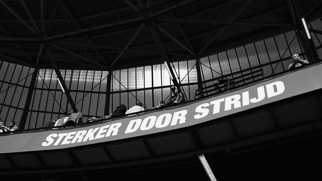 Sterker Door Strijd Feyenoord Rotterdam Slogan Stronger Through Fighting Feyenoord Stadium De Kuip Soccer Fans Waiting For the Match Of The Day against Ajax of Amsterdam Built Structure Low Angle View Architecture Outdoors City Day Audience Horizontal (c) 2016 Shangita Bose All Rights Reserved From My Point Of View Love The Game