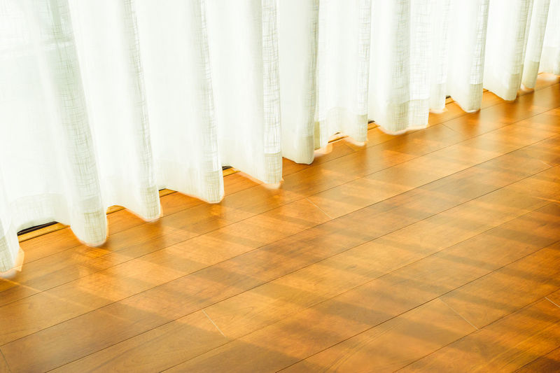 White curtain on hardwood floor at home