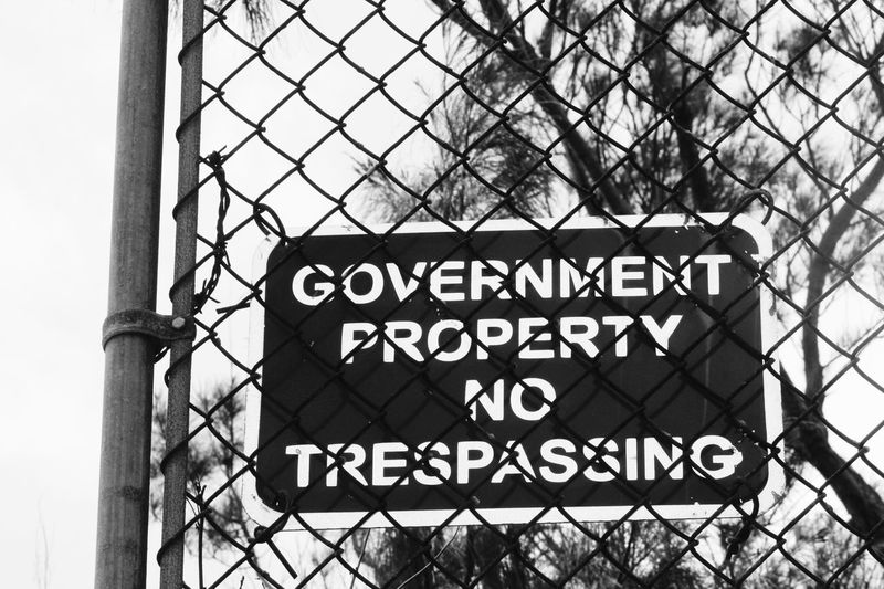 Just a sign Trespassingforart Trespassing No Trespassing No Trespassing Sign Government Property Western Script Text Communication Day Outdoors No People Architecture Sky Close-up