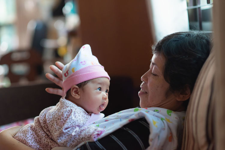 Grandmother playing with granddaughter at home