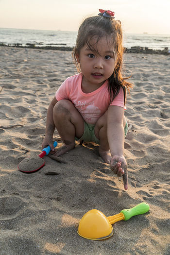Sand Pail And Shovel Sea Full Length Beach Childhood Water Sunset Sand Summer Pink Color