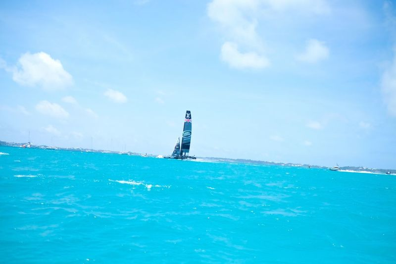 Sea Sky Water Lighthouse Day Safety Protection Guidance Outdoors Cloud - Sky Scenics Waterfront Direction Nature Blue Beauty In Nature Horizon Over Water Tranquility Nautical Vessel No People