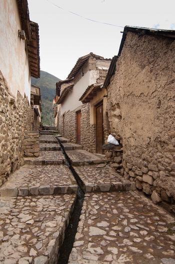 Narrow street leading to building