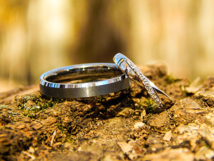 Close-up of wedding rings on field