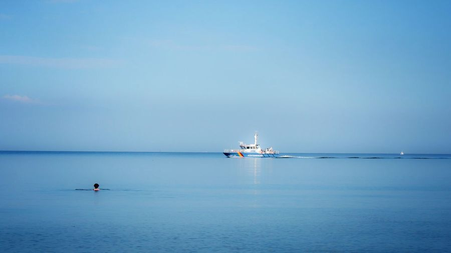 Boat Moving On Sea Against Blue Sky