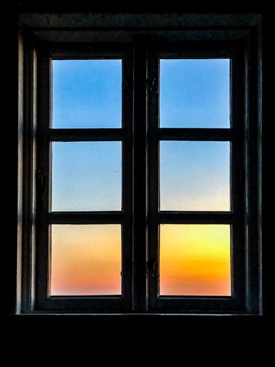 Sunset through a window frame Window Glass - Material Sky No People Sunset Indoors  Transparent Nature Window Frame Close-up Closed Geometric Shape Sunlight Built Structure Clear Sky Glass Day Orange Color Architecture
