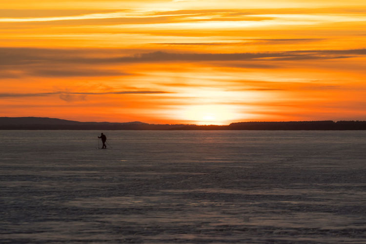Sky Ski Skiing Scenics - Nature Beauty In Nature Tranquility Tranquil Scene Nature Canada Coast To Coast Orange Color Orange Orange Sky Sunset Silhouette Water Cloud - Sky Sea One Person Waterfront Idyllic Land Unrecognizable Person Lifestyles Real People Outdoors Horizon Over Water
