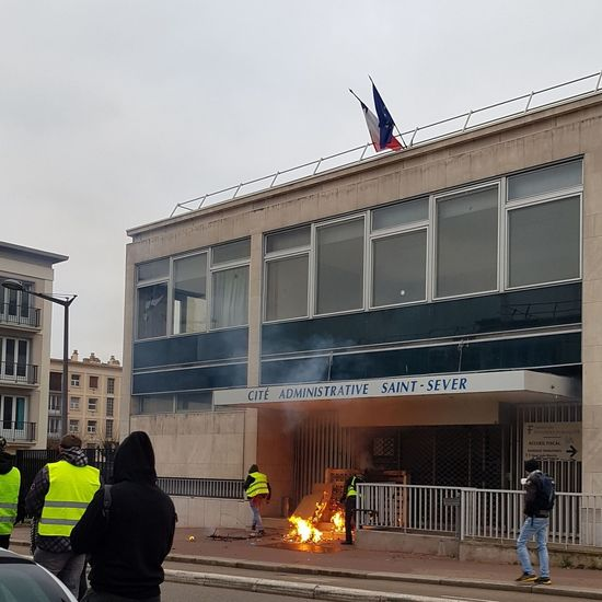 People on street against building in city