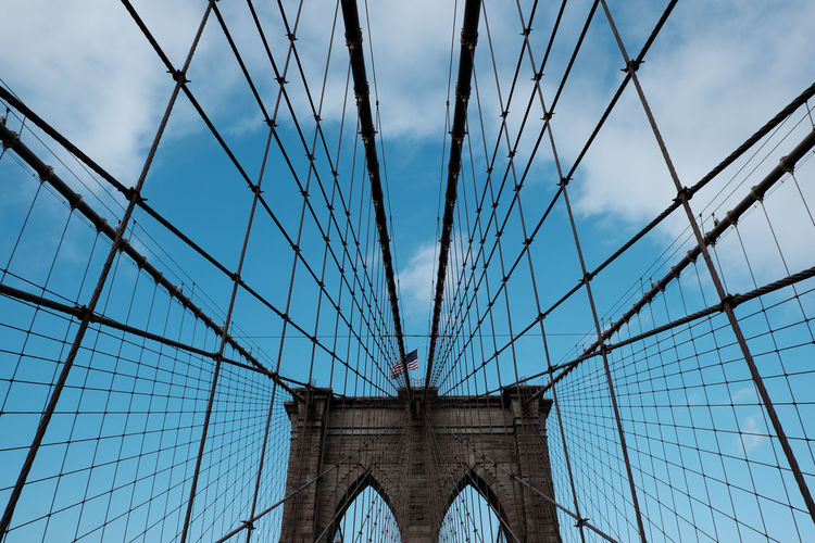 New York City. Symmetry. Arch Architecture Bascule Bridge Bridge - Man Made Structure Brooklyn Bridge / New York Building Exterior Built Structure Cloud - Sky Connection Day Engineering Low Angle View No People Outdoors Sky Suspension Bridge Symmetry Transportation