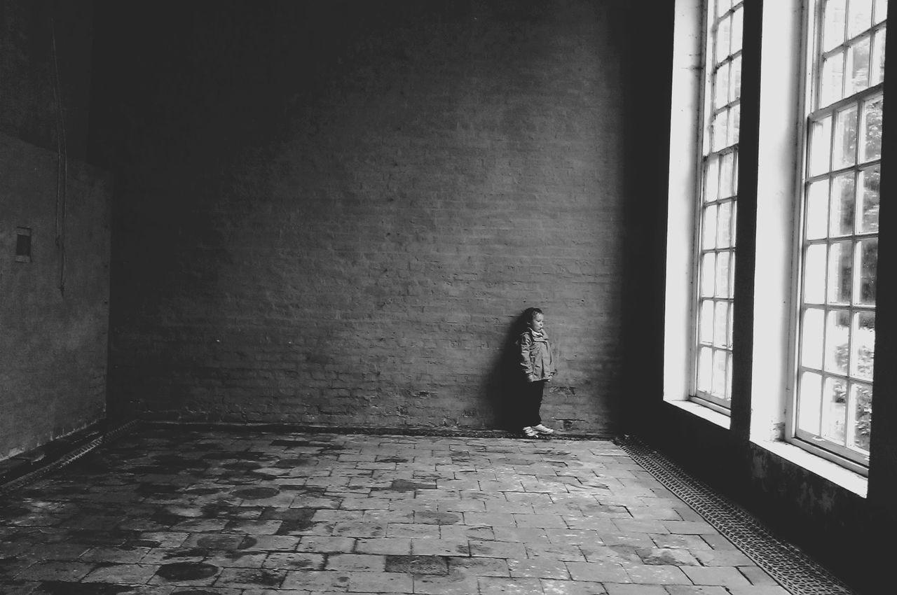 View Of Girl In Empty Room
