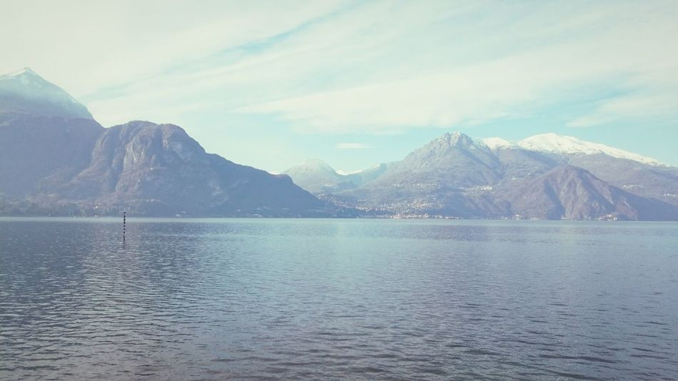 Narrow Mountains Everything In Its Place Perspective Como Lake Como Pastel Power Landscape Reflection Blue Sky Water Lake Lakeshore Sea Blue Faded Fading Light Appearance Mirage Here Belongs To Me Relaxing Landscapes With WhiteWall Light Blue Learn & Shoot: Balancing Elements Summer Exploratorium