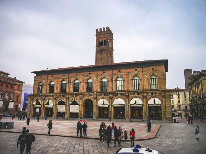 Market Piazza Maggiore Adult Architecture Building Exterior Built Structure City Clock Day History Large Group Of People Outdoors People Real People Sky Travel Travel Destinations