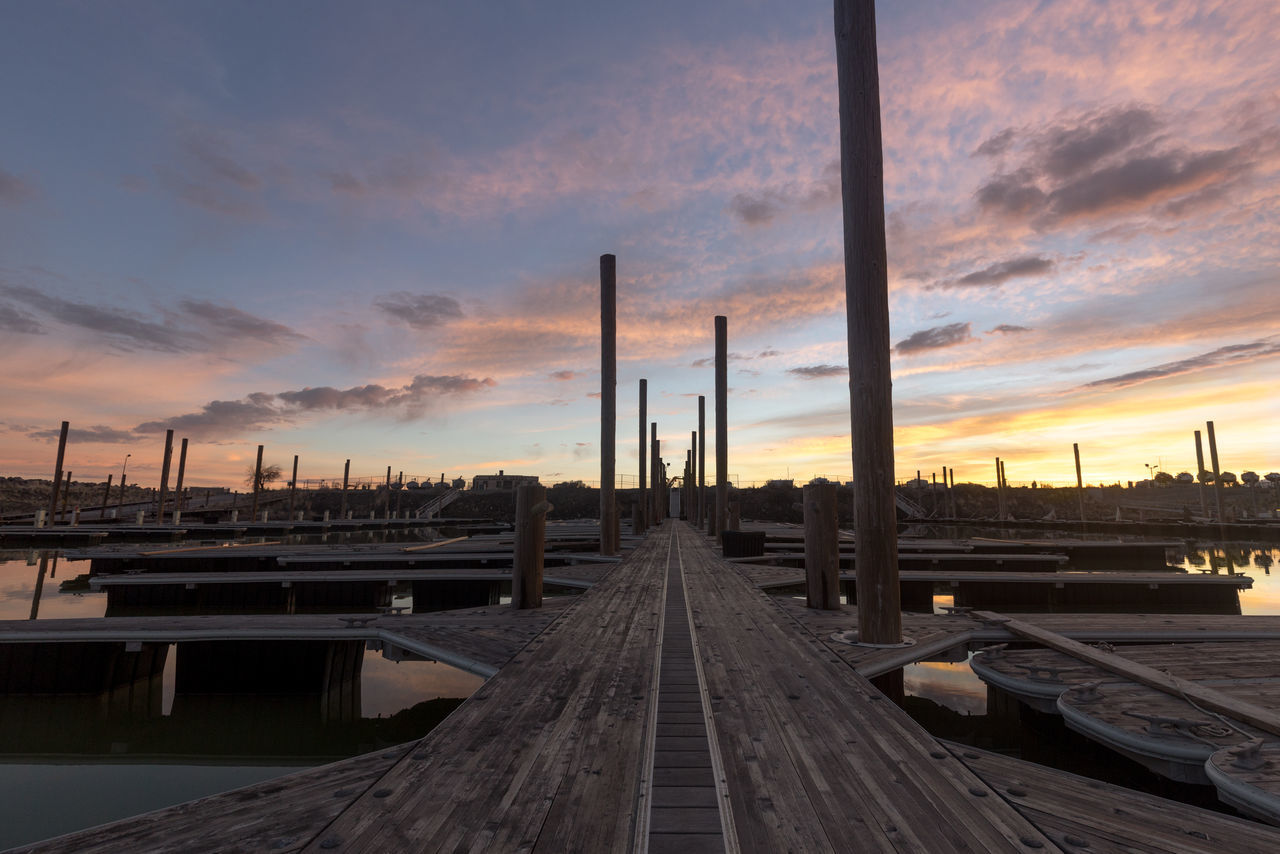 sky, cloud - sky, no people, railroad track, sunset, built structure, transportation, rail transportation, industry, smoke stack, outdoors, architecture, nature, day, shipyard