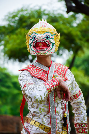 Man wearing mask during traditional festival