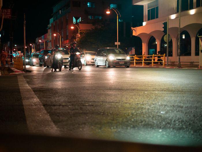 Illuminated city street and buildings at night