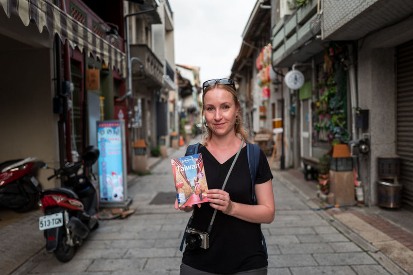Tainan, Taiwan Adult Architecture Building Exterior Built Structure Casual Clothing City City Life Day Emotion Focus On Foreground Front View Happiness Holding Looking At Camera One Person Outdoors Portrait Smiling Street Young Adult
