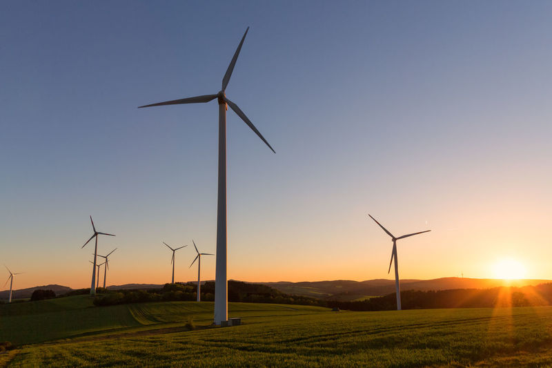 Renewable Energy Fuel And Power Generation Environment Wind Turbine Alternative Energy Environmental Conservation Turbine Wind Power Sky Sunset Technology Landscape Nature Field Land Beauty In Nature Sun No People Rural Scene Sunlight Electricity  Outdoors Sustainable Resources Wind Power Supply