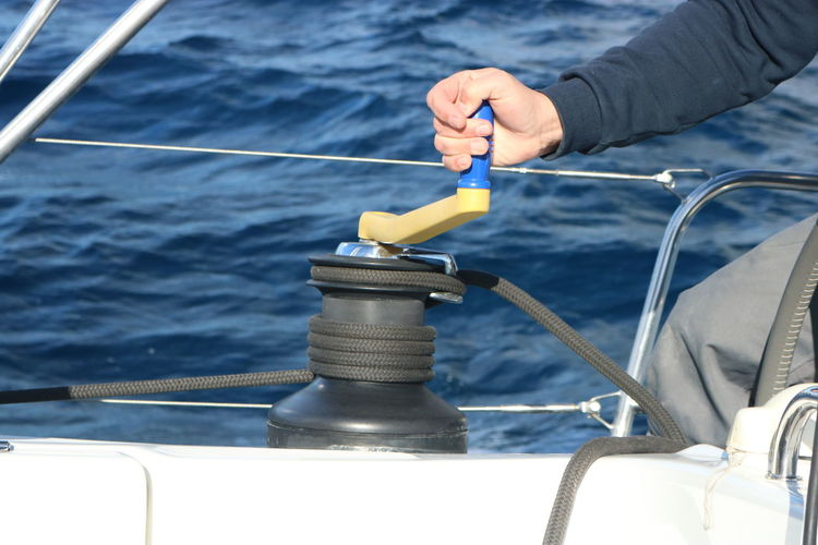 Close-up of hand holding lever in sailboat