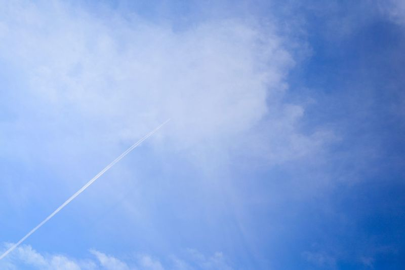 Vapor Trail Contrail Low Angle View White Sky Beauty In Nature Nature Blue Day Majestic Scenics Outdoors No People Cloud - Sky Contrail